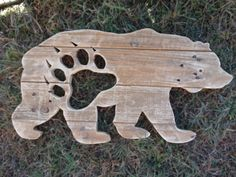 This bear is made from reclaimed pallet wood. It has a bear paw print cut from the flank. It has been hand cut with a jig saw and it comes with a wire hanger on the back. Tape measure in second photo for reference.