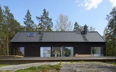 Modern black barn style house