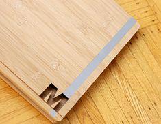 Custom bamboo portfolio book with die-cut and aluminum inlay treatment for Miyah Schlichter, an Arts Institute Interior Design graduate.