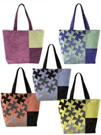 Twister Tote Bag Pattern by Around the Bobbin at KayeWood.com. Create fun and easy pinwheels on this large tote using the popular Lil' Twister tool or have fun featuring color-blocked panels or fun prints using the basic tote instructions. Lined tote with interior pockets and a magnetic snap closure. Directions for making large oversized pockets or smaller subdivided pockets. http://www.kayewood.com/item/Twister_Tote_Bag_Pattern/3436 $9.50