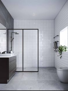 Make a statement with a black framed showerscreen. It'll open up the space but also create visual interest