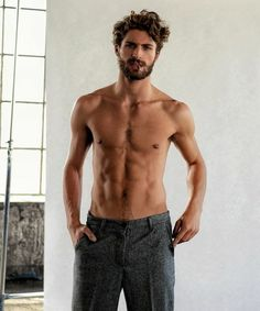 Lean And Muscular Topless Man With A Beard And Mustache Smoking A Cigarette Haircuts For Men With Curly Hair Dark Gray Tweed Trousers