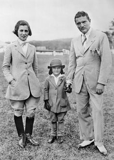 Jacqueline Kennedy Onassis with her parents