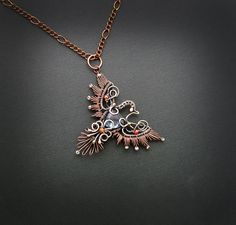Anastasiya Ivanova creates exquisite jewelry made of copper and natural stones using a wire wrapping technique.