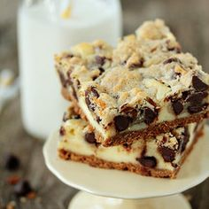 Cookie Dough Cheesecake Bars — Punchfork  Brown sugar, packed light (1/3 cup)  Chocolate chips (1 cup)  Flour (3/4 cup)  Granulated sugar (3 tablespoons)  Salt (1/4 teaspoon)  Sugar (1/4 cup)  Vanilla, pure (2 teaspoon)  Graham cracker crumbs (1 1/2 cups)  Dairy  Butter, unsalted (10 tablespoons)  Cream cheese (10 oz)  Egg, large (1)