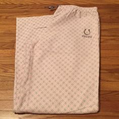 """Indianapolis Colts flannel sleep pants Pants are flannel with embroidered horseshoe and """"colts"""". Pants are a powder pink with gray and white stripes. Elastic waistband with a ribbon drawstring in gray. Official NFL team apparel NFL Intimates & Sleepwear Pajamas"""