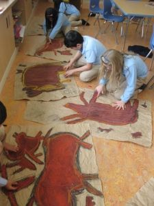 Cave Painting Art Study, paint and chalk pastel on brown paper. Pictograph Lesson and additional petroglyph project with rocks. Check out how the teacher creates a cave out of the school hallway to display the projects. Neat.