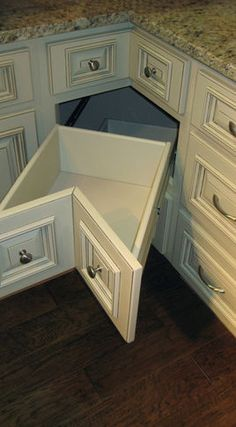 Drawers in the corner cabinet...