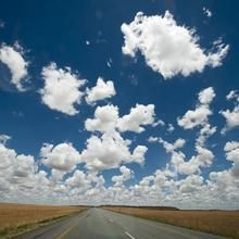 Trans Karoo.  Where the road stretches far beyond the horizon and the clouds rush by overhead