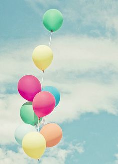 pastel rainbow balloons in the sky