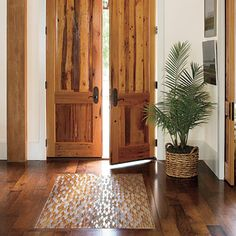 The front door of your home is a key element for good feng shui. Learn how to make your front door a strong, welcoming portal for nourishing energy. Staircase Remodel, Entry Hallway, Entry Doors, Entryway Rug, Coastal Cottage, Home Interior, Interior Doors, Interior Design, Southern Living