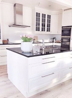 White kitchen cabinet with black countertop Home Decor Kitchen, Rustic Kitchen, Kitchen Interior, Kitchen Dining, Small Apartment Interior, Wood Interior Design, Kitchen Stories, Cuisines Design, Küchen Design
