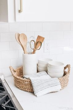 My Kitchen Remodel Reveal! The perfect set-up for next to … My Kitchen Remodel Reveal! The perfect set-up for next to your range! A round woven tray holds most-used utensils in a pretty marble holder, a hand towel, and white patterned bowls! Küchen Design, House Design, Interior Design, Interior Doors, Interior Styling, Gray And White Kitchen, White Kitchen Decor, White Decor, Modern Kitchen Decor