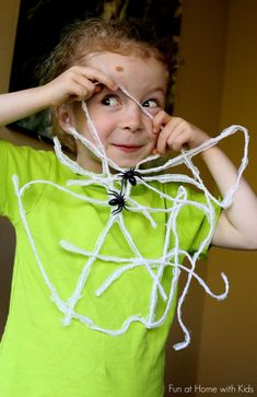 Kid-Made Halloween Decorations:  Hanging Spiderwebs from Fun at Home with Kids