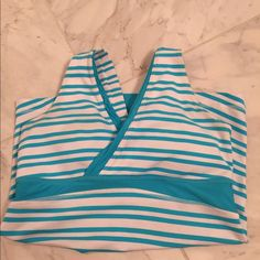 LuluLemon Sz 6 Blue striped top Stripes are in this season!! Bright blue striped Lulu top with a built in bra. No tears, stains or issues. Gently used. lululemon athletica Tops Tank Tops