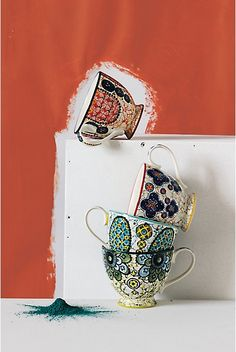 """Kebaya Mug. Inspired by the resist-dyeing technique of Dutch wax fabric, colorful stoneware is the perfect vessel for your morning cup of Arabica.  Stoneware.  Dishwasher and microwave safe.  13 oz.  3.5""""H, 4.5"""" diameter.  http://www.anthropologie.com/anthro/catalog/productdetail.jsp?id=073191&catId=HOME-TABLETOP-DINNERWARE&navCount=66&navAction=top&isProduct=true&pushId=HOME-TABLETOP-DINNERWARE&popId=HOME-TABLETOP-DINNERWARE&fromCategoryPage=true&color=046&subCategoryId=HOME-KITCHEN-MUGS"""