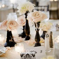 Black Vases with White Roses and Feathers :: Centerpiece Idea