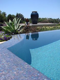 Infinity pool with mosaic tile. Lovely! Via AMS Landscape Design Studios, Inc.