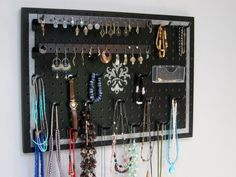 Organizer your jewelry and easily find the piece you're looking for! This wall-hanging organizer has a contemporary silver design on a black background that really highlights your jewelry. Many different decorative designs can be seen in the shop's Etsy listings. Jewelry Organizer by JansJewelryOrganizer, $47.95