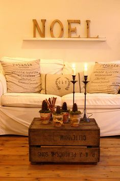 I want a comfy couch like this. And, love the coffee table idea