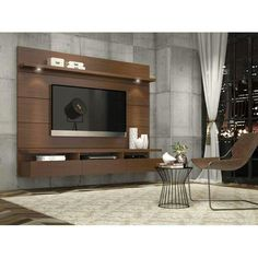 Manhattan Comfort Cabrini Theater Entertainment Center Panel in Nut Brown-Hosting the Super Bowl? Enjoying a quiet intimate evening at home? Your TV has never looked better mounted on the Cabrini Theater Panel. Simply attach it to the panel using Panneau Mural Tv, Tv Wall Design, House Design, Screen Design, Lcd Unit Design, Design Shop, Tv Wall Panel, Tv Wanddekor, Floating Entertainment Center