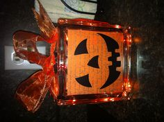 DIY Halloween glass block. AWESOME! Glass block from craft store, Halloween card stock paper for the inside, simple vinyl design for the face from the craft store. String of white lights for the inside.