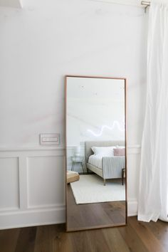 A rose gold floor mirror completes the Palm Springs vibes of the room!