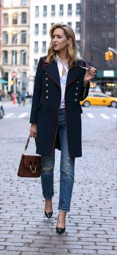 navy military coat with red piping and brass double-breasted buttons, classic white button down shirt, ripped straight-leg boyfriend jeans, patent leather pointy toe navy pumps, medium brown leather pierce bag, round sunglasses, gold chokers {Mango, Levi'