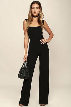 With a chic blazer, leather jacket, or coat, there's no end to how you could style the Enticing Endeavors Black Jumpsuit! This sleeveless jumpsuit is made from lightly textured knit with a squared-off neckline, and seamed bodice. High-waisted pant legs fall to a classic wide cut. Hidden back zipper.