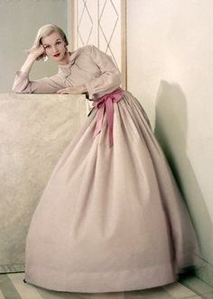 This is a beautiful pink, just subdued enough to be sophisticated. Jean Patchett 1950's.