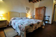 A bedroom of La Fattoria del Rio di Sopra. Agriturismo in Umbria. Lago Trasimeno