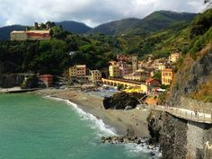 We stay in Monterosso, in the Cinque Terre to swim, eat scrumptious Italian food, hike the trails over the hillside to visit the Cinque Terre villages, and live #LaDolceVita.  #ItalyTravel, #WomenInItaly
