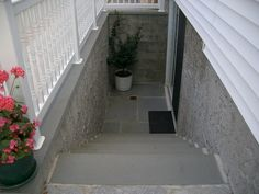 Basement entrance with pvc rail and slate finished steps/landing