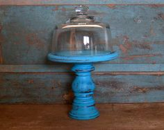 A personal favorite from my Etsy shop https://www.etsy.com/listing/259223531/pedestal-cloche-turquoise-distressed