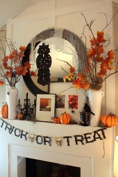 Love the Halloween pix in the gallery frames . 50 Awesome Halloween Decorating Ideas White Fireplace with Floral Pumpkins Decor Halloween Mantel, Spooky Halloween Decorations, Fete Halloween, Creepy Halloween, Holidays Halloween, Halloween Crafts, Outdoor Halloween, Halloween Garland, Halloween Sweets