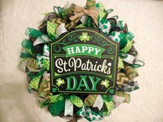 Bring a little luck of the Irish to your door with this 24 x 8, black, green and white St. Patricks Day Wreath! This pub style sign wreath was created with a black deco mesh, twists of emerald green and green striped burlap deco mesh, shamrock, chevron, polka dot and shimmer ribbons along with loops of emerald green decorative tubing. This stylish and green popping wreath is topped with a burlap bow pulling this piece all together! Tip your glass to your successful purchase on this one of a…