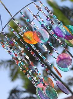 Wind chime sun catcher - another craft project with melting beads! Great for kids to help with! My daughter will