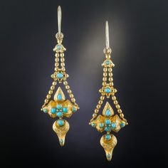 Rare and ravishing original Victorian drop earrings, measuring two inches long, light, and lovely (they drop a bit further from the ear wires), expertly hand fabricated in rich 18K yellow gold in a fun and fanciful articulated (lots of movement) three-dimensional design. Dotted with bright turquoise half beads, the festive earrings swing and sway from delicate split chains. Superb and stunning, circa 1875.