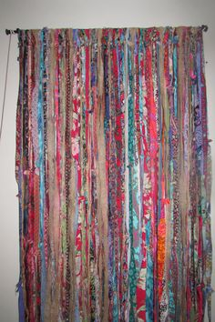 Unique, Very Boho, Gypsy Hippie Style Fabrics in Rayon, Polyester Upcycled skirts, dresses, scarves, Silk Saris, vintage fabrics ~ Many rich jewel tones ~ Curtain, Banner, Garland, Room Divider, Photo Backdrops, Sliding Door, Teen Room, Sunroom, Shower Curtain, Wedding, Shower, Dorm Room Constructed on rope, with top tied in such a way that allows you to transfer it over to a curtain rod of your choice very easily. The width can be adjusted either wider, up to at least or more narrow if…