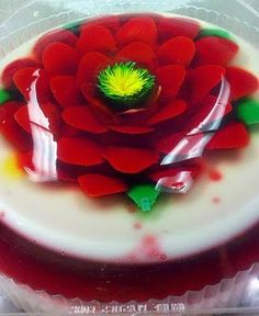 The flowers are made by slicing the jello and injecting jello where the slice was made. Here's a video that demonstrates the technique