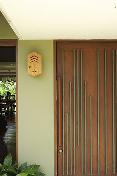 As one of the first statements that guests will notice, the front door of a house can be designed as a foretelling of things to come. In this case, the Lagdameo door was inlaid with wood in vertical configurations. Philippines House Design, Philippine Houses, Two Storey House, Wood Front Doors, House And Home Magazine, Filipino, Home Interior Design, House Tours, Tall Cabinet Storage