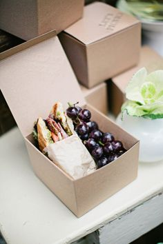 """Boxes with the """"picnic"""" inside -- kids can each have a box and take to eat in living room while we watch Peppa Pig."""