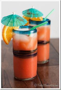 Rum Punch: lime juice, pineapple juice, orange juice, spiced rum, dark rum, coconut rum, grenadine