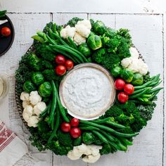 veggies and dip to the next level with this colorful crudité wreath. This vegetable appetizer is a stunner with white cauliflower, red tomatoes and green broccoli, green beans, snap peas, kale and Brussels sprouts. Homemade Ranch Dip, Vegetable Appetizers, Vegetable Recipes, Wiener Schnitzel, Christmas Appetizers, Clean Eating Snacks, Fresco, Appetizer Recipes, Healthy Appetizers
