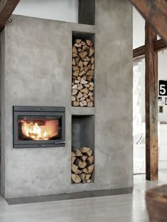 concrete fireplace with firewood storage