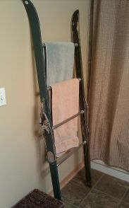 Upcycled snow skis into blanket ladder