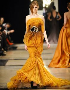 A model wears a creation from the Stephane Rolland spring/summer 2011 collection at Paris haute couture.  That's some swirling mustardy goodness, if you ask me!