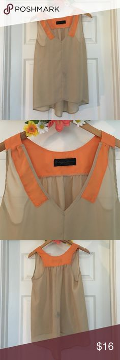 Fun flowy blouse size medium This is a fun and flowy beige blouse with vibrant orange details! So fun and different! Would look so cute with a blazer and jeans! Only worn a few times and in great condition! Size medium Tops