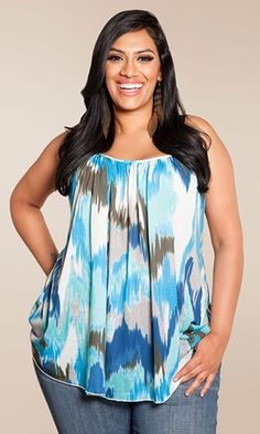 Love this top as a plus size apple shape it does wonders to make a hip line appear and make your stomach disappear. I also love her hair.