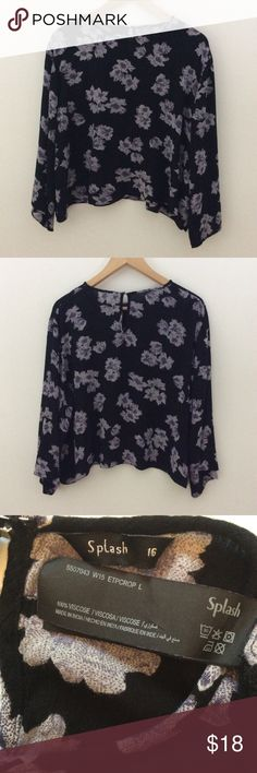 """Long Bell Sleeve Floral Top Cute black top with lavender flowers, long bell sleeves and a keyhole back.  Slight material fray on inside near hook (See last pic) cannot be seen when worn. *Note: Please check the """"measurements."""" It is a size 16 (UK sizing)  A 16 is equivalent to our 12.  Length:  20"""", Bust: 24 1/4"""", Sleeve Length: 17 3/4""""   Measurements are approximate.  Smoke Free/Dog Friendly Home🌸 Splash Tops"""